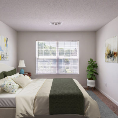 Gorgeous bedroom carefully decorated with greens and whites at Windshire Terrace Apartments