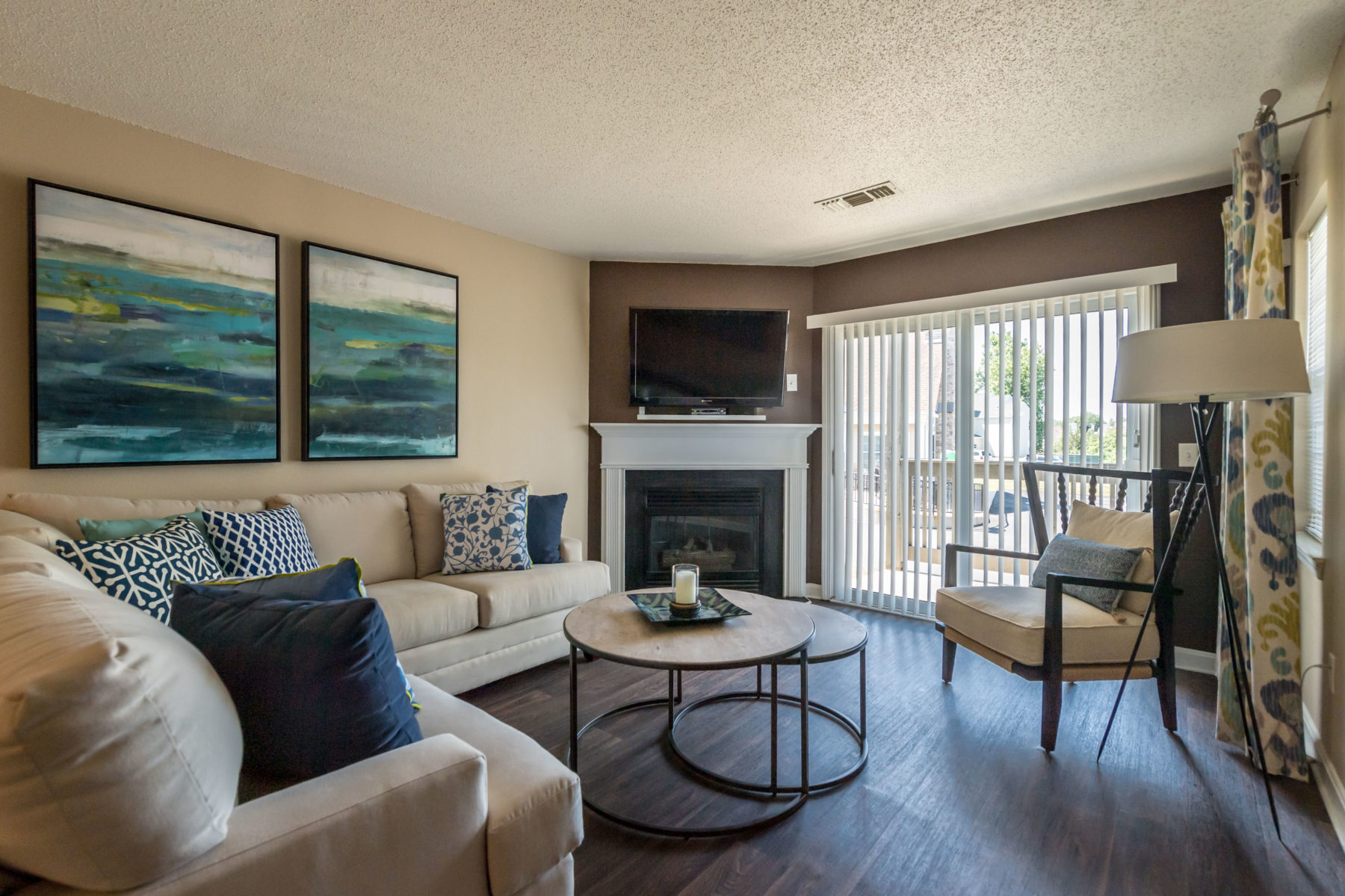Gorgeous living room with wood floors and fireplace at Windshire Apartments